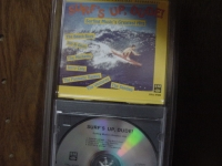 """""""Surf's Up, Dude, Surfing Music's Great Hits (rare 80's long box packaging)"""" - Product Image"""